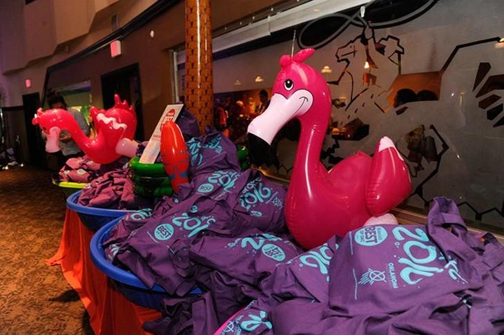 Best of OKC appreciation swag bags fill kiddie pools at Will Rogers Theatre.