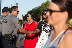 Oklahoma City Black Lives Matter marchers shake hands with Oklahoma City Police officers during the July 10 rally in Bricktown. (Emmy Verdin)