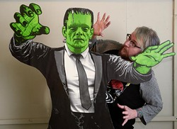 Art Sunday poses for a photo with Frankenstein's monster to promote the Underground Monster Carnival, Tuesday, Feb. 7, 2017. - GARETT FISBECK