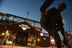 Fans filter in and out of the Chickasaw Bricktown Ballpark during the season opener with the OKC Dogers vs Round Rock Express, 4-9-15.  mh