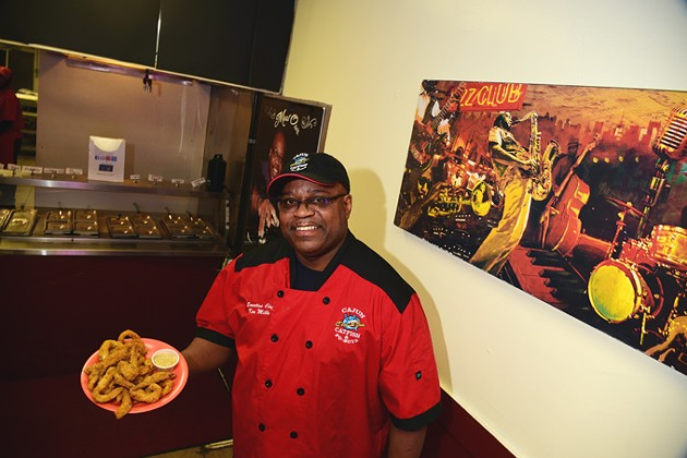 C'est Si Bon owner, Ken Mills, with a plate of fresh fried catfish.  mh