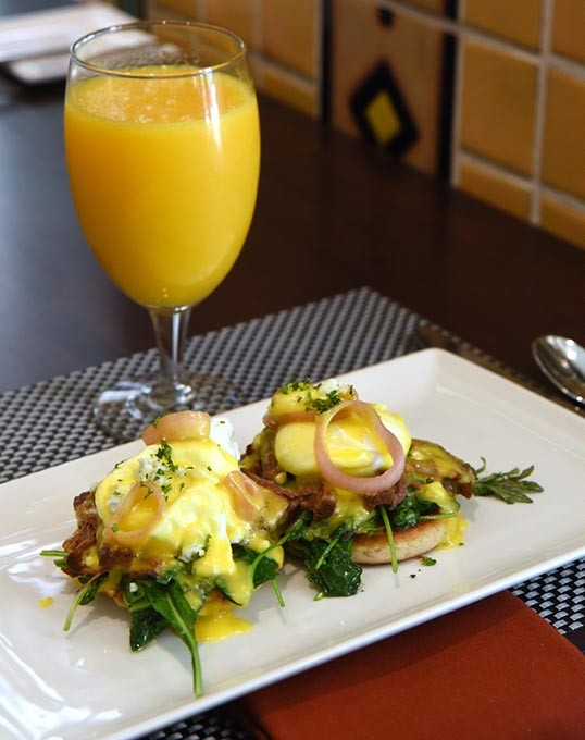 Braised short rib benedict with kale and orange juice at Park Avenue Grill in the Skirvin.  mh