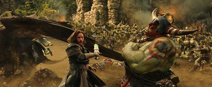 """Commander Anduin Lothar (TRAVIS FIMMEL) defends himself against an orc from The Horde in """"Warcraft.""""  From Legendary Pictures and Universal Pictures comes """"Warcraft,"""" an epic adventure of world-colliding conflict based on Blizzard Entertainment's global phenomenon. - PHOTO CREDIT: LEGENDARY PICTURES"""