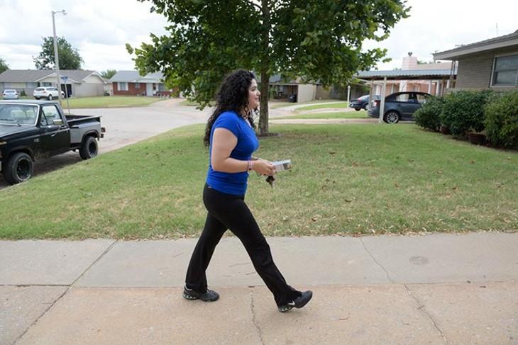 Elizabeth Larios campaigns in a neighborhood in Moore, Thursday, Aug 18, 2016. - GARETT FISBECK