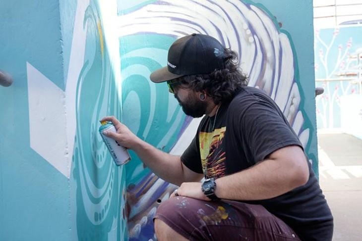 Artist Sean Vali helps create colorful public art at northwest OKC's Eugene Field Elementary school. (Garett Fisbeck)