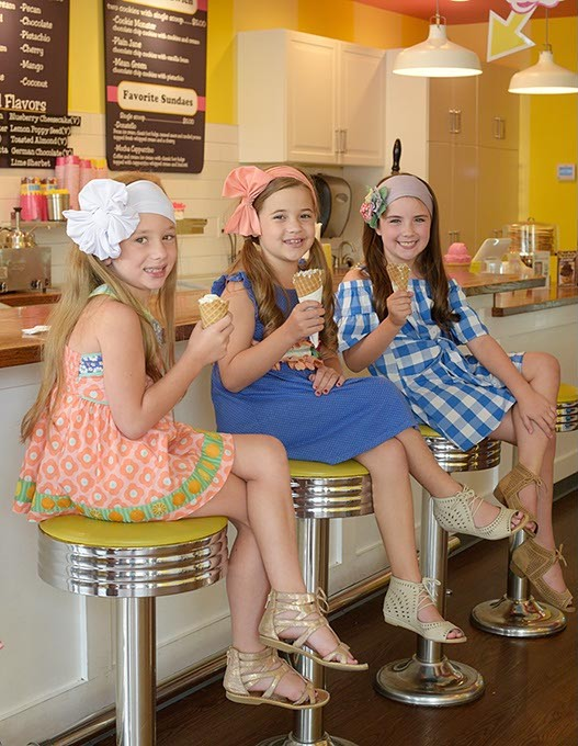 Journey Morgan, 7, Paizley Morgan, 8, and Berkley Burroughs, 7, pose for a photo with their ice cream cones at Roxy's Ice Cream Social, Wednesday, Aug. 2, 2017. - GARETT FISBECK