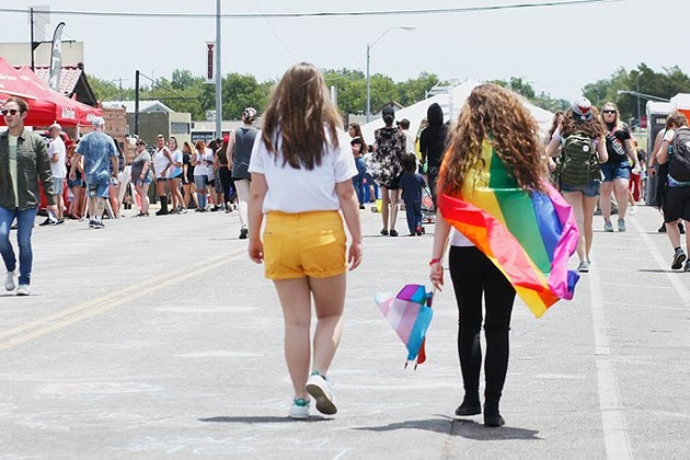 Pride flags of all kinds are one of the biggest parts of Pride festivals and parades. They are often carried, or worn around the neck like capes. (Cara Johnson).