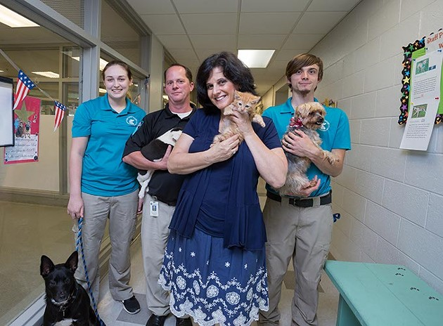 OKC Animal Shelter Supervisor, Julie Bank, poses for a photo with her staff and adoptable dogs and a kitten on Monday, June 27, 2016 in Oklahoma City. - EMMY VERDIN