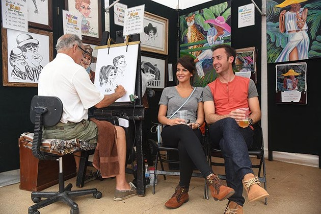 Kelly Killough of Kelly Killough Studios makes caricatures of Ayla Amonovic and Ryan Moore at the 2015 Paseo Arts Fest.  mh