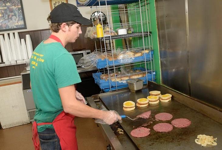 Michael Scott works the grill at Barry's. | Photo Garett Fisbeck