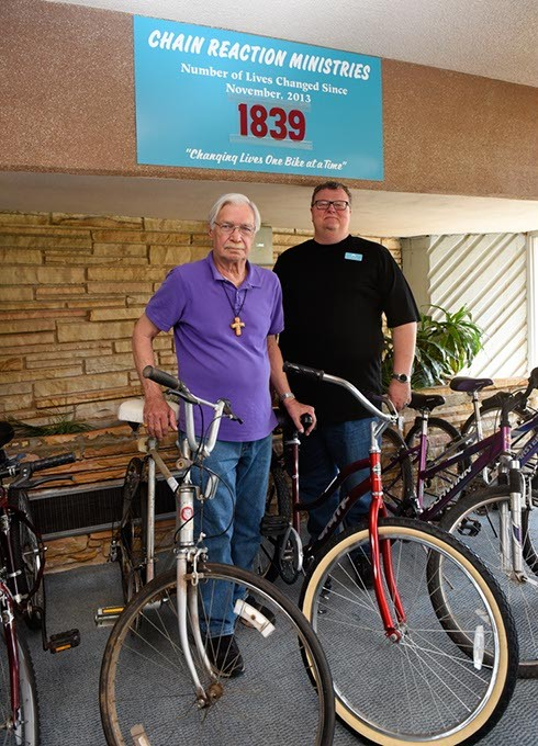 Larry Batten and Rev. John Maiget pose for a photo at Chain Reaction Ministries at First Christian Church, Friday, May 27, 2016. - GARETT FISBECK