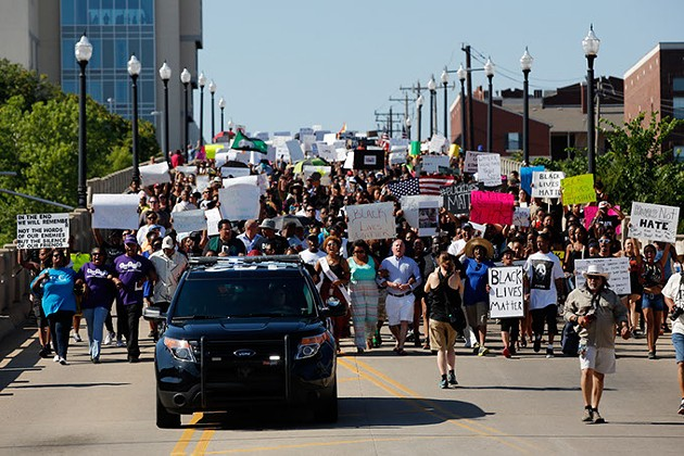 Protesters march during a Black Lives Matter demonstration in Oklahoma City, Sunday, July 10, 2016. - GARETT FISBECK
