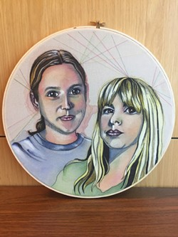 from left Deluxe Winter Market founders J.D. McCoy and Sara Cowan are immortalized in a piece by artist Reagan Kloiber. | Photo Deluxe OK, LLC / provided