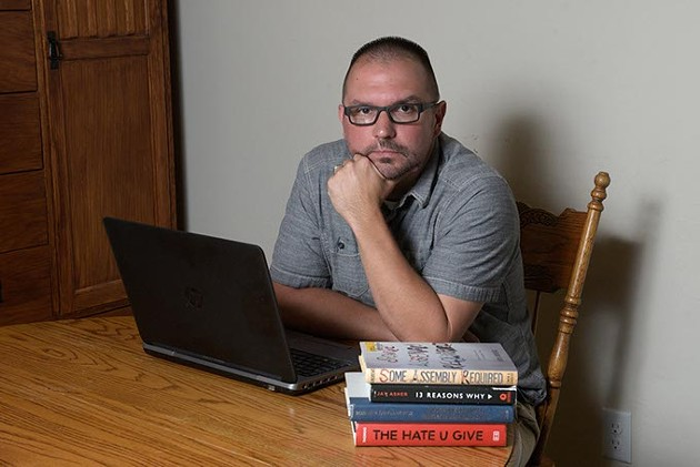 Aaron Baker, Mid-Del teacher, at his home in Edmond, Thursday, June 15, 2017.  Baker wants all students to be safe and supports LGBT protections added to district policies. - GARETT FISBECK