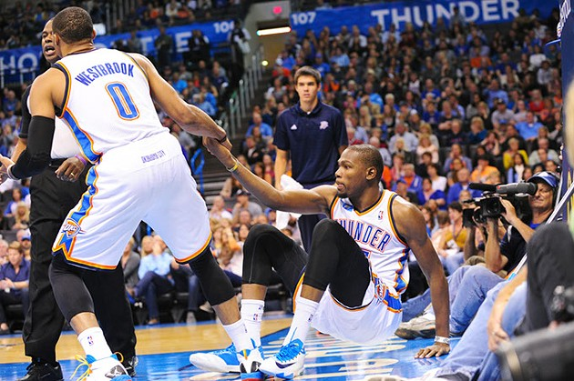 OKC Thunder player Russell Westbrook helps Kevin Durant up off the court after a tumble in this 2013 photo.   Photo Gazette / file