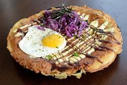 Okonamiyaki savory pancake with fried egg and red cabbage (Garett Fisbeck)