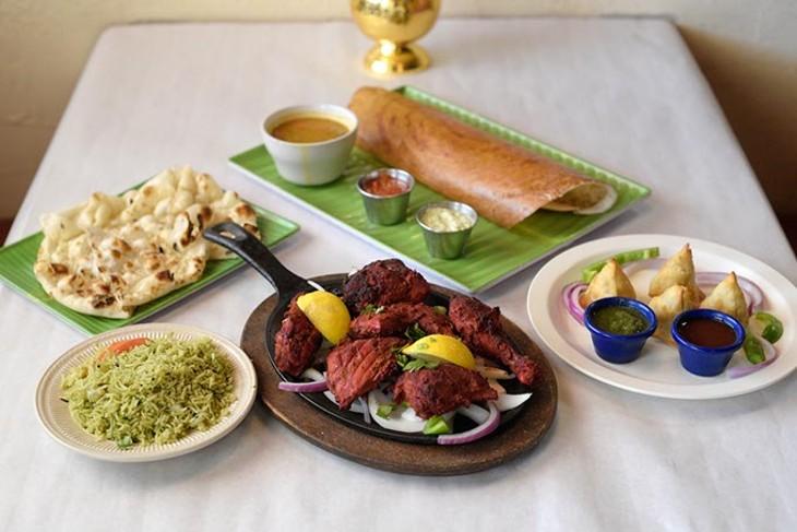 Tandoori chicken, ? - masala dosa, simosas, rice and naan at Himalaya's in Moore, Thursday, July 20, 2017. - GARETT FISBECK