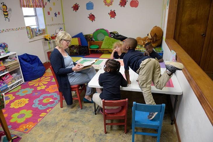 Bea Tunnell reads to a Pre-K class at Little Light Christian School, Thursday, March 2, 2017. - GARETT FISBECK