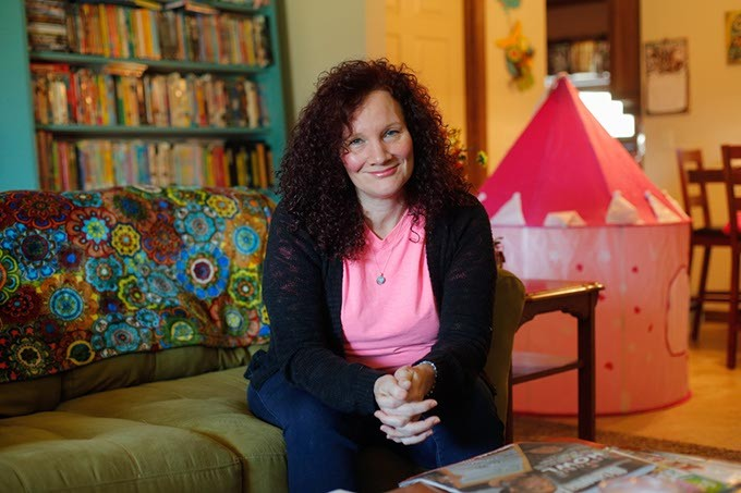Angie Ward poses for a photo at her home in The Village, Friday, March 31, 2017. - GARETT FISBECK