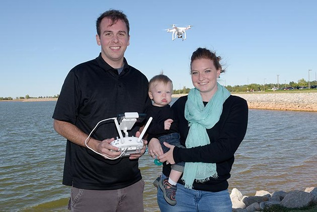 Aaron and Alyssa Brackett, of Oklahoma Drone Photography, pose for a photo with their son, Caden, at Lake Hefner, Friday, Oct. 7, 2016. - GARETT FISBECK