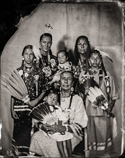 """Casey Camp-Horinek, Citizen of Ponca Tribe of Oklahoma, """"Zhuthi,"""" and Lola Williams, Citizen of Ponca Tribe of Oklahoma, Granddaughter of Casey Camp-Horinek, Age 2, and Diane Fafa, Citizen of Ponca Tribe of Oklahoma, Granddaughter of Casey Camp-Horinek, Age 10, and Matheanna Williams, Citizen of Ponca Tribe of Oklahoma, and Isaiah Williams, Ponca, Age 1, and Jewel Camp, Citizen of Ponca Tribe of Oklahoma, and Serena Horinek, Citizen of Ponca Tribe of Oklahoma, Granddaughter of Casey Camp-Horinek (Will Wilson / Fred Jones Jr. Museum of Art / provided)"""