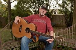 Musician Kent Fauss poses for a photo at his home, Tuesday, Oct. 25, 2016. - GARETT FISBECK