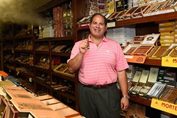 Todd Naifeh poses for a photo at ZT Cigars, Tuesday, May 31, 2016. - GARETT FISBECK
