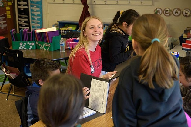 Abby Shelley, Americorps volunteer, works with children during an afterschool program at Hilldale Elementary, Thursday, April 6, 2017. - GARETT FISBECK