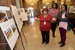 Tiffani Sanders talks about her participation with the Photovoice Project as Vanessa Morrison and Cheryl Sanders look on at the Oklahoma City Municipal Building, Tuesday, Jan. 24, 2017. - GARETT FISBECK