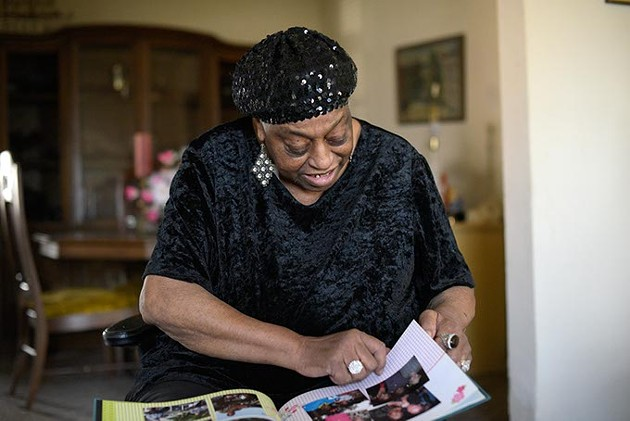 Miss Blues digs through old posters and photographs at her home in Oklahoma City, Tuesday, March 14, 2017. - GARETT FISBECK