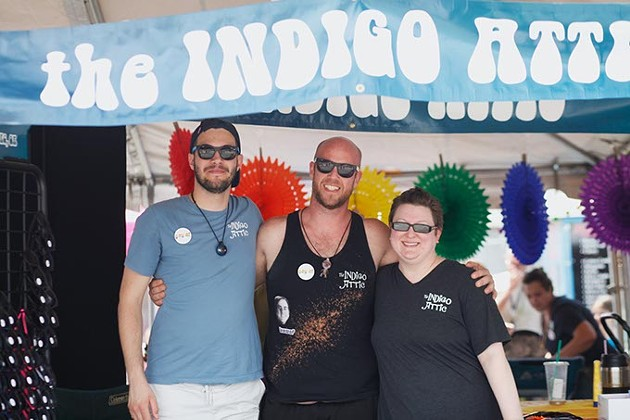 Susan Lawrence, owner of Indigo Attic in Oklahoma City, stands with staff members Aaron Riffa, left, and Matt Burdt. Indigo Attic had a booth at the Pride Art Festival on Saturday, June 24, 2017 handing out free sunglasses, pens, bracelets and coupons promoting their shop. (Cara Johnson).
