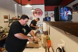 Isaac Barton and Alan Grande make sandwiches at the Sandwich Club, Monday, July 18, 2018. - GARETT FISBECK