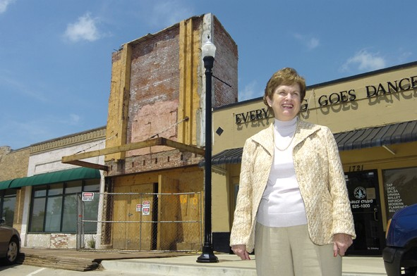 In 2007, Paula Stover looks out over the Plaza District with Lyric Theatre's front facade under renovation in the background. | Photo Gazette / file