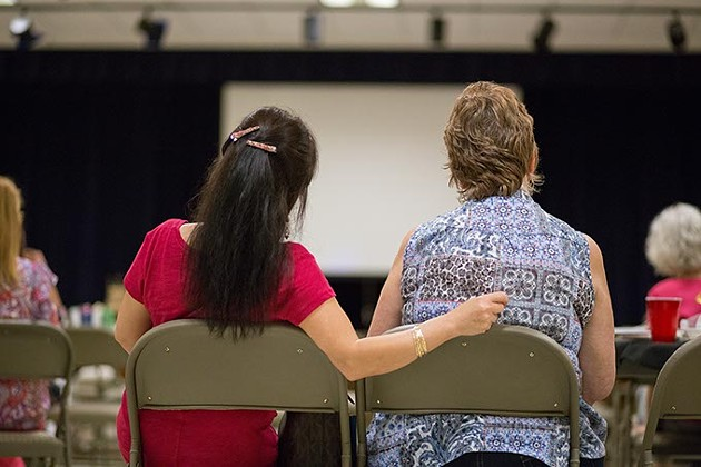 Gisela Huyssen sits next to her daughter, Sonja Lieu Lambert at the reunion.  Gisela Huyssen and her husband Ulrich Huyssen adopted 23 Vietnamese children to American families at the end of the Vietnam war on Saturday, July 2, 2016 in Oklahoma City. - EMMY VERDIN