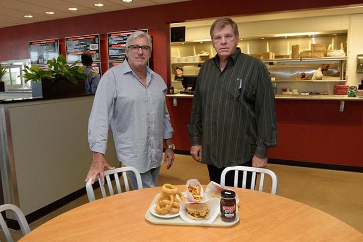 Rick and David Haynes poses for a photo at Johnnie's in Yukon, Tuesday, Nov. 1, 2016. - GARETT FISBECK