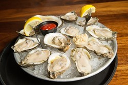 Oysters on the half shell at Trapper's Fish Camp, Wednesday, July 6, 2016. - GARETT FISBECK
