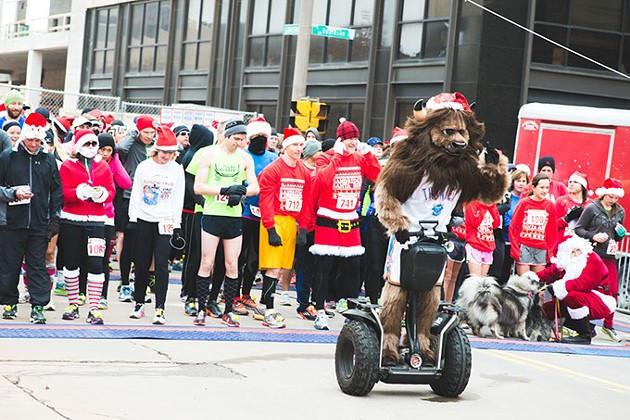 Oklahoma City Thunder mascot Rumble leads runners during Downtown in December's Sandridge Santa Run. This year's event is Dec. 10. | Photo provided - QUIT NGUYEN