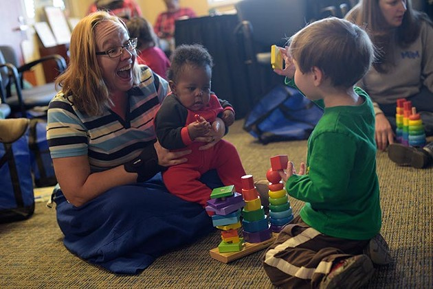Colleen Wilcox plays with her son Luck, 2, and Elijah during an Early Bird class at Metro Career Academy, Friday, Feb. 3, 2017. - GARETT FISBECK