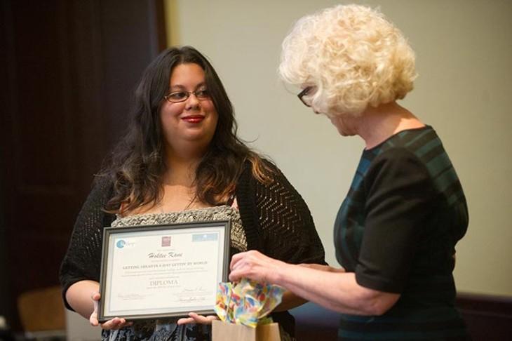 Deborah Price presents Hoktee Kane her diploma during a ReMerge graduation at the Oklahoma City Community Foundation, Thursday, June 30, 2016. - GARETT FISBECK