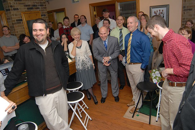 Ryan Tate (center) with coworkers in 2008. (Gazette file)