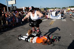 """Twisted Armani jumps over Lita-Lita Ho' Beta and Princess Mayhem during 2015 OKC Pride Parade. OKC Pride's theme for 2017 is """"30 years of resistance."""" The nonprofit organization is celebrating 30 years of Pride celebrations this year. - GARETT FISBECK / FILE"""