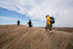 Hikers trek the grasses of Four Canyon Preserve in western Oklahoma as part of a field trip with the Oklahoma chapter of The Nature Conservancy.   Photo Ryan West / The Nature Conservancy / provided
