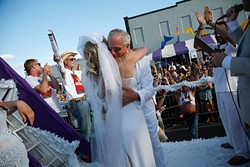 """A couple gets married during the 2015 OKC Pride Parade. OKC Pride's theme for 2017 is """"30 years of resistance."""" The nonprofit organization is celebrating 30 years of Pride celebrations this year. - GARETT FISBECK / FILE"""