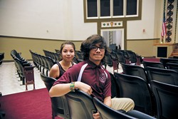 from left Angelica Herrera and Jesus Medrano, seated in their school's auditorium, are two of the 143 students enrolled in Capitol Hill High School's Academy of Arts.   Photo Laura Eastes
