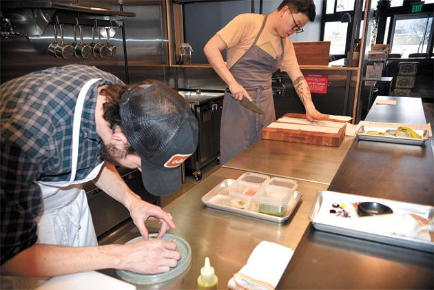 Chefs Colin Stringer and Paul Wang plate dishes inside the kitchen at Nonesuch. | Photo Jacob Threadgill