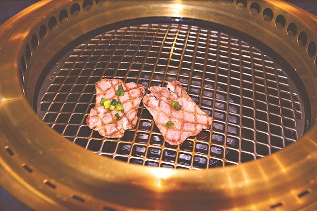 Meats cook on a personal grill imported from Japan. (Photo Jacob Threadgill)