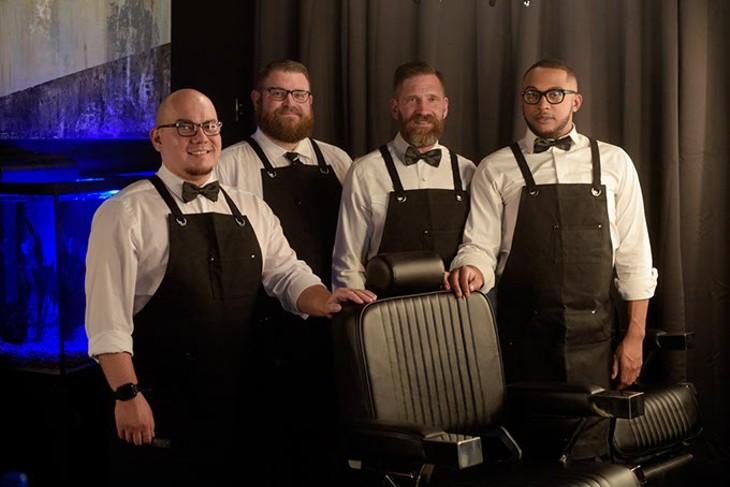 Nick Norris, Joel Robinson, Ben Grunewald and Eric Grunewald staff Manscape & Massage Clinic. (Garett Fisbeck)