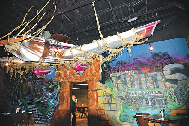 A giant plane hangs suspended in The Ruins Bar & Grille. (Photo Jacob Threadgill)