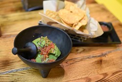 Customers decide how chunky to make the DIY guacamole. | Photo Jacob Threadgill