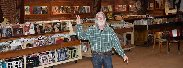 Trolley Stop Record Shop owner John Dunning keeps thousands of vinyl records in stock at his new store location in the old Penn Theater. (Photo Ben Luschen)